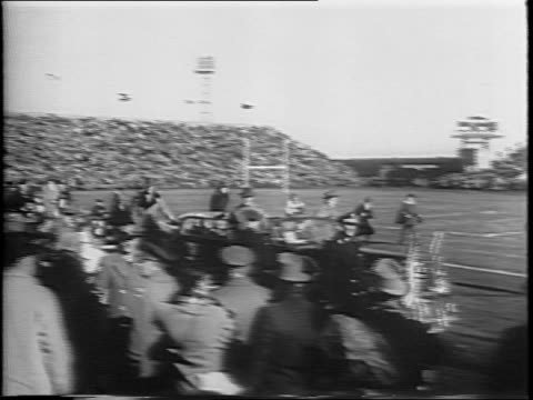 stockvideo's en b-roll-footage met aerial view of philadelphia municipal stadium / long shot of spectators in stands / close up of motion picture cameras / high angle shot of president... - margaret truman