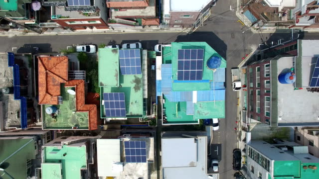 stockvideo's en b-roll-footage met aerial view of photovoltaic power generation on the roof - renewable energy