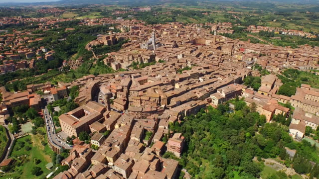 aerial view of piazza del campo and cattedrale metropolitana di santa maria assunta in siena - sunny stock videos & royalty-free footage