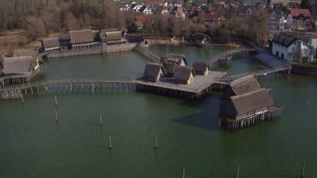 aerial view of pile dwelling in unteruhldingen unesco - stilt house stock videos & royalty-free footage