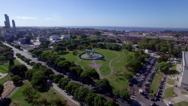 aerial view of plaza naciones unidas flower and park - argentina stock-videos und b-roll-filmmaterial