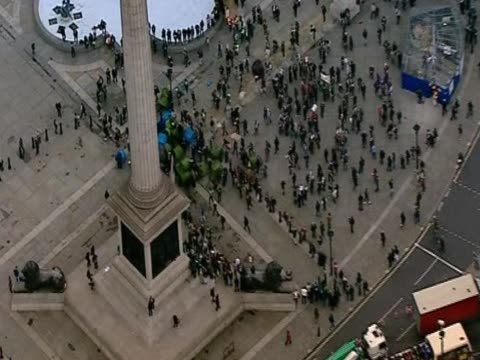 Aerial view of police removing tents in Trafalgar Square during student protest against higher tuition fees in universities