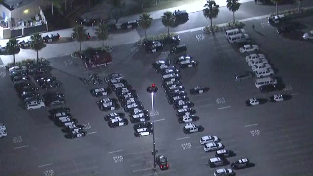 aerial view of police vehicles outside donald trump rally at the pacific amphitheatre in costa mesa on april 28, 2016. - costa mesa stock videos & royalty-free footage
