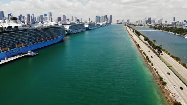 aerial view of port miami with cruise ships docked during covid-19 pandemic, coral princess with sick passengers just allowed to dock, miami, florida, united states of america, north america - marina stock videos & royalty-free footage