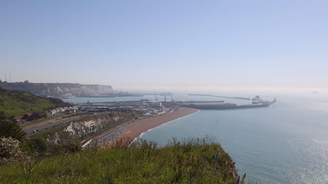 aerial view of port of dover, white cliffs of dover in background in dover, kent, u.k., on tuesday, june 1, 2021. - cliff stock videos & royalty-free footage