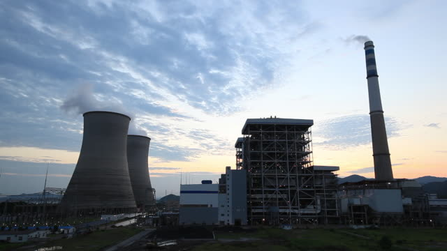 aerial view of power station chimneys - cooling tower stock videos & royalty-free footage