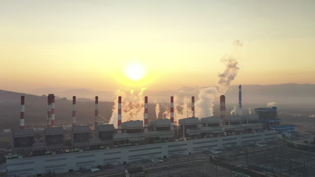 aerial view of power station plant coal fired power station in morning, smoking chimneys power station - cooling tower stock videos & royalty-free footage