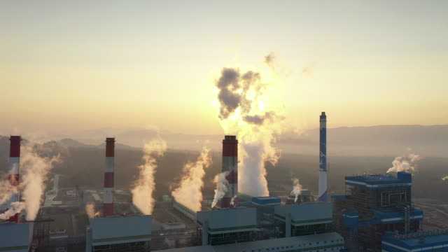 aerial view of power station plant coal fired power station in morning, smoking chimneys power station - coal stock videos & royalty-free footage