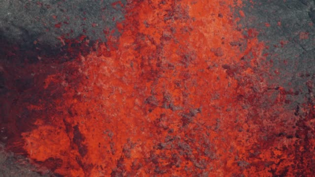 aerial view of powerful volcano red hot magma - eruzione video stock e b–roll