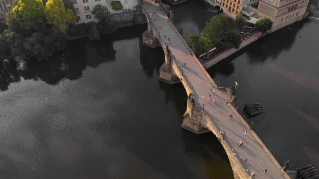 aerial view of prague at twilight with vltava river - prague stock videos & royalty-free footage