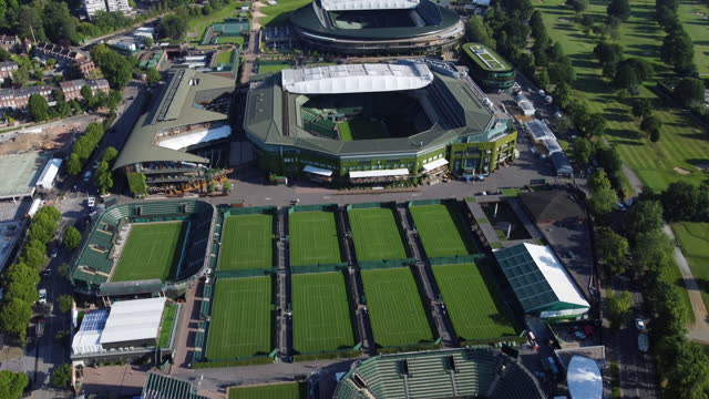 aerial view of pristine wimbledon tennis courts. tracking in and up. - capital cities stock videos & royalty-free footage