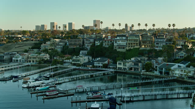 aerial view of privately owned docks in corona del mar - aerial - moored stock videos & royalty-free footage