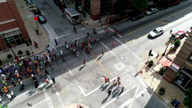 aerial view of protestors marching in the streets of st. louis missouri - protestor stock videos & royalty-free footage
