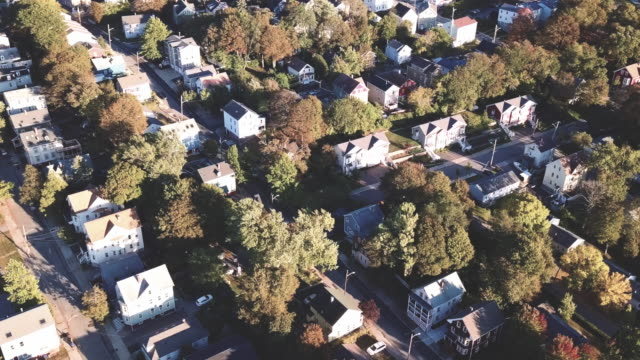 vidéos et rushes de aerial view of providence, rhode island suburbs during the autumn of 2017 - rhode island