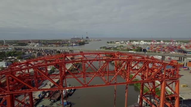 aerial view of puente transbordador nicolas avellaneda bridge in buenos aires - buenos aires stock videos & royalty-free footage