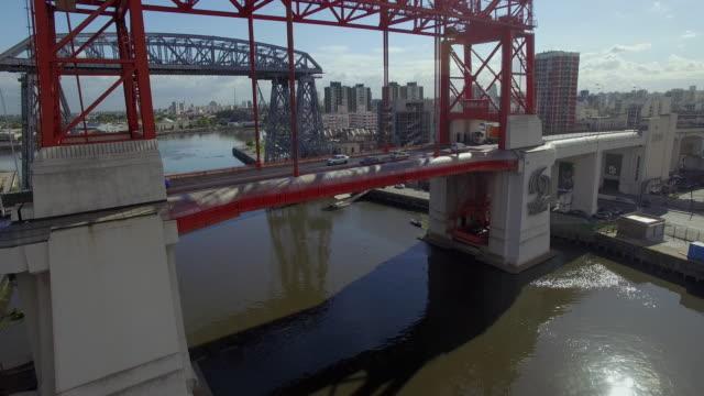 aerial view of puente transbordador nicolas avellaneda bridge in buenos aires - puente video stock e b–roll