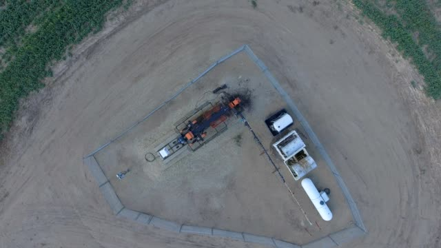 aerial view of pumpjack in a farmers field - alberta stock videos and b-roll footage