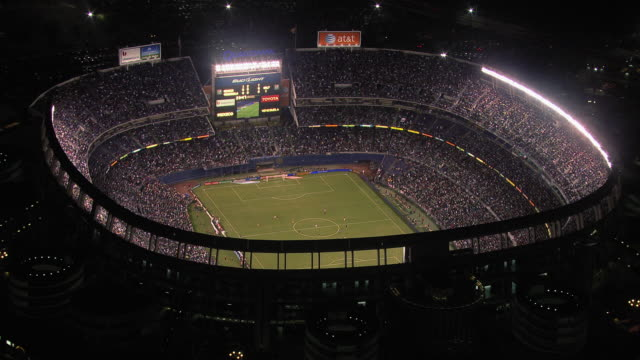 vídeos de stock e filmes b-roll de aerial view of qualcomm stadium at night, san diego, california, united states of america - football
