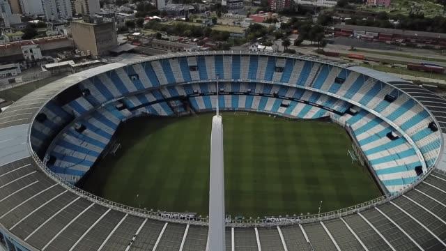 vídeos de stock e filmes b-roll de aerial view of racing presidente juan domingo perón stadium. on march 27, 2020 in buenos aires, argentina. national government has ordered a lock... - argentina