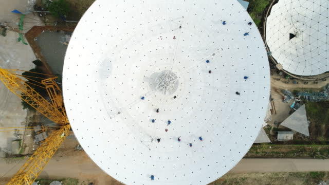 aerial view of radio telescope in china - global communications stock videos & royalty-free footage