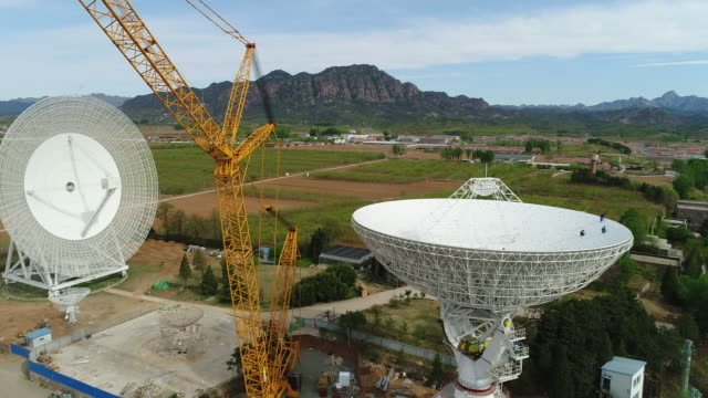 aerial view of radio telescope in china - astronomical telescope stock videos & royalty-free footage