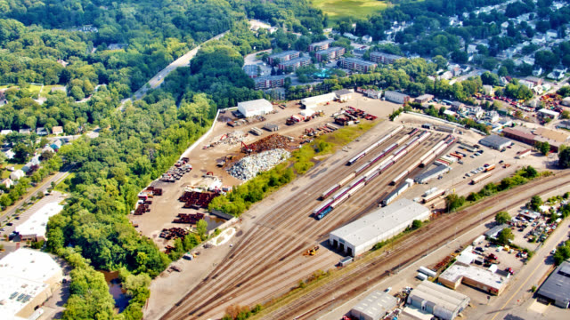 aerial view of rail station, industrial. - railway station stock videos & royalty-free footage
