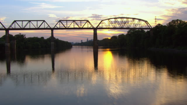 aerial view of railroad bridge over cumberland river during sunset, nashville, tennessee, united states of america. - nashville stock videos & royalty-free footage