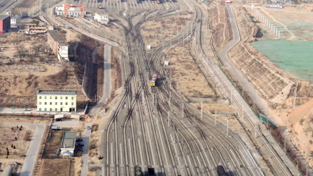 aerial view of railway shunting yard in lanzhou, china - 線路のポイント点の映像素材/bロール