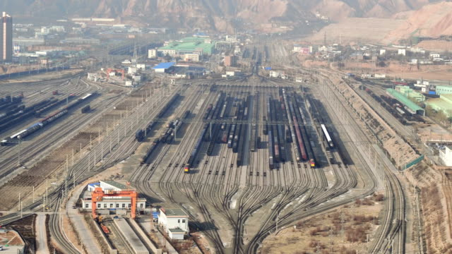 aerial view of railway shunting yard in lanzhou, china - schienenverkehr stock-videos und b-roll-filmmaterial