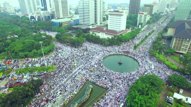 aerial view of rally in jakarta thousands of people from different muslim organizations protesting jakarta's governor for what he said before he was... - protestor stock videos & royalty-free footage