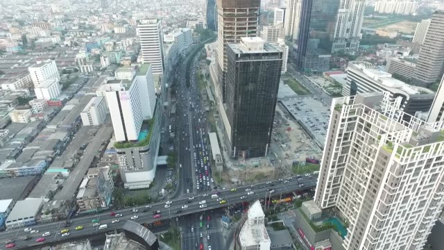 aerial view of rama 9 junction and ratchadapisek road area in bangkok thailand no - bangkok bildbanksvideor och videomaterial från bakom kulisserna