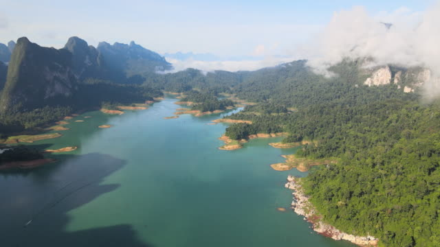 aerial view of ratchaprapha dam in thailand - lagoon stock videos & royalty-free footage