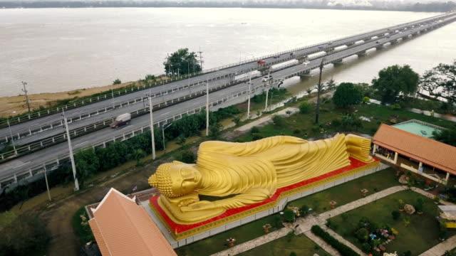 Aerial view of Reclining Buddha at Wat Phranon Laem Pho, Ko Yo, Songkhla