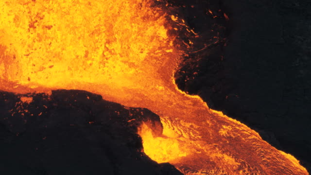 aerial view of red hot volcanic magma flowing - tectonic stock videos & royalty-free footage