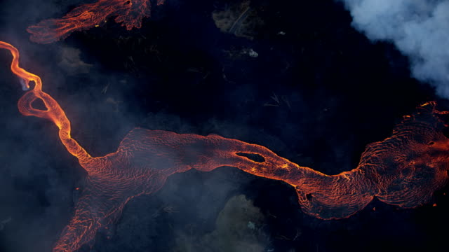 aerial view of red hot volcanic magma flowing - kilauea stock videos & royalty-free footage