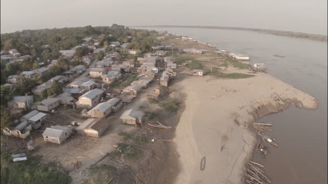 aerial view of regional amazon village port - higher view - riverbank stock videos and b-roll footage
