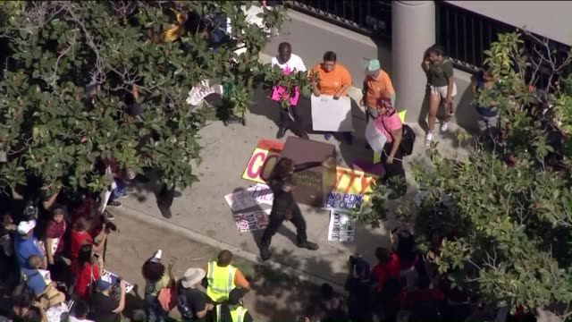 ktla aerial view of rent control protest in los angeles - lease agreement stock videos & royalty-free footage
