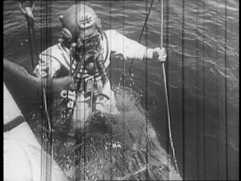 aerial view of rescue ship uss falcon / side view of falcon / sailor working signal light on ship / view of rescue submarine uss trout / view of uss... - diving helmet stock videos and b-roll footage