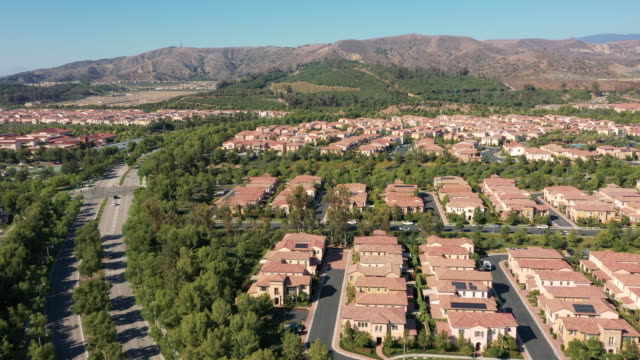 4k aerial view of residences in an urban setting during the day - century city stock videos & royalty-free footage
