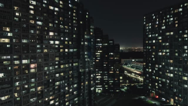t/l pan aerial view of residential area at night / beijing, china - smart city stock videos & royalty-free footage