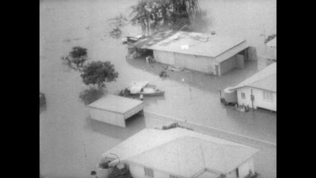 aerial view of residential area in queensland where streets are submerged from flood waters / destruction of buildings and loss of property as seen... - audio available stock videos & royalty-free footage