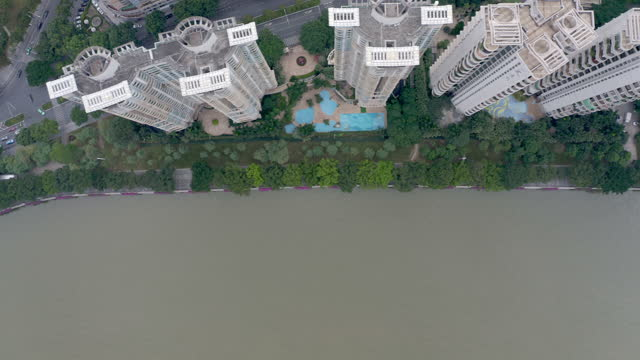 aerial view of residential building along the river - liyao xie stock videos & royalty-free footage