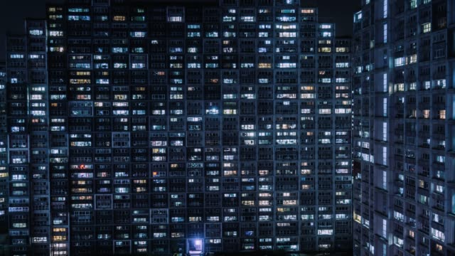 T/L Aerial View of Residential Building, Windows Twinkling at Night / Beijing, China