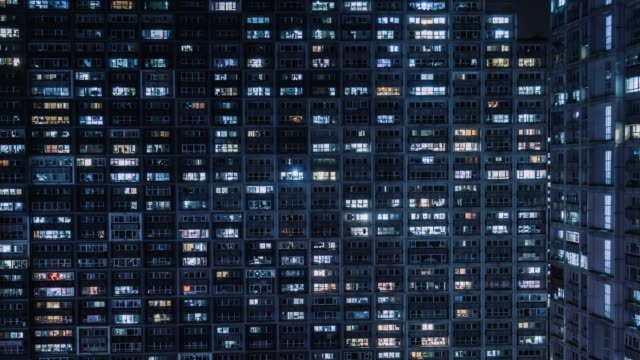 t/l td aerial view of residential building, windows twinkling at night / beijing, china - smart city stock videos & royalty-free footage