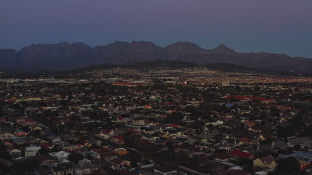 aerial view of residential district of strand, cape town at dusk - cape town stock videos & royalty-free footage