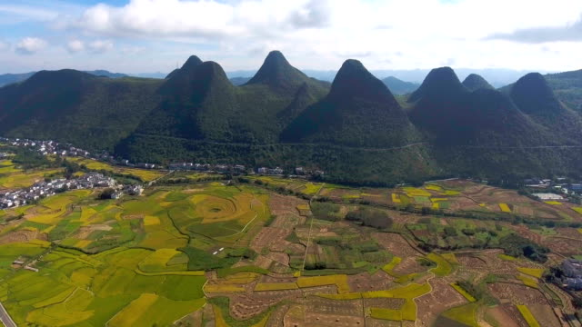 Aerial view of Rice Terrace and Traditional Chinese Village in Green Valley, Guizhou Province, China