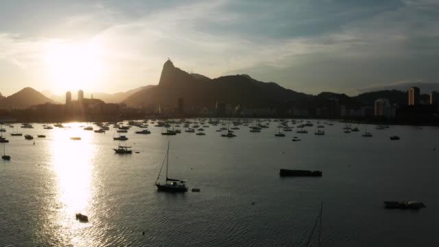 aerial view of rio de janeiro at susnet, brazil. botafogo bay. - copacabana beach stock videos & royalty-free footage