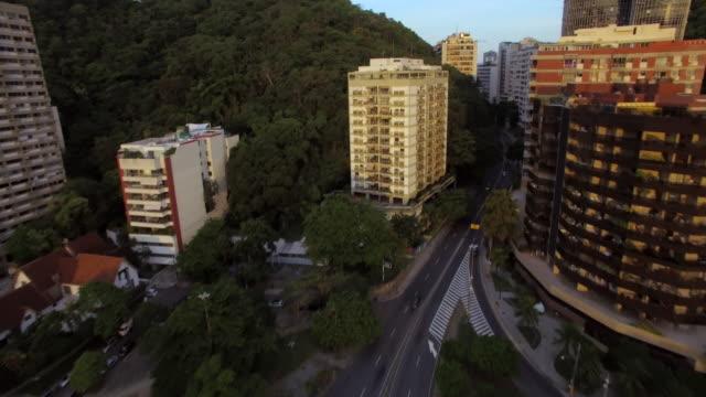 aerial view of rio de janeiro lagoon and copacabana - panoramica verso l'alto video stock e b–roll