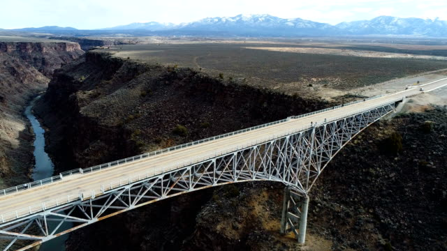 aerial view of rio gorge bridge in new mexico backing far away from the bridge - new mexico stock videos & royalty-free footage
