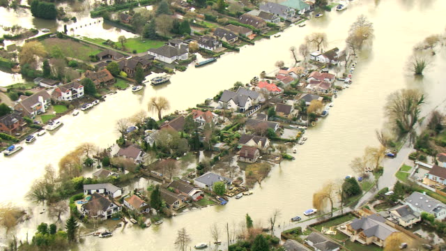aerial view of rising floodwater southwest england uk - surrey england stock videos & royalty-free footage